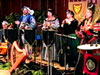Players in period costume demonstrate the instruments and sounds of the 13th Century and discuss madrigals, canons, and ancient instruments.